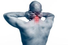 Injury of the neck. Young bald man sportive physique stretched and clings to a sick neck on a white isolated background. Stretching the neck stock photos