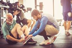 Injury. People at gym. royalty free stock images