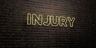 INJURY -Realistic Neon Sign on Brick Wall background - 3D rendered royalty free stock image. Can be used for online banner ads and direct mailers Stock Photography