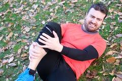 Knee injury and man runner exercising with leg pain Stock Photo