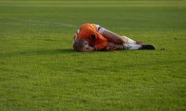 Injury sports. Injury , Minor injury , soccer, player, playing, cramp, crash, human leg, playing field, men Stock Image