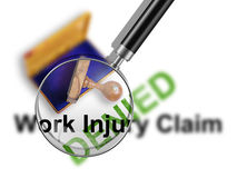 Injury. Top view of a rubber stamp with a giant word Work injury claim - denied    isolated on white background Royalty Free Stock Photography