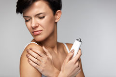 Free Injury Treatment. Beautiful Woman With Arm Pain, Applying Cream Stock Photography - 84467642