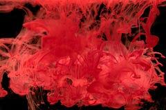 Ink att virvla runt i vatten, färgdroppe i vatten som fotograferas i motio Arkivbilder