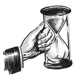 Sand clock. Ink black and white illustration of a male hand holding a big sand clock Royalty Free Stock Photography