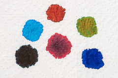 Ink blobs. Several fountain pen ink colours on a sheet of white paper royalty free stock images