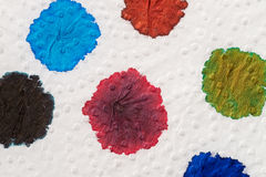Ink blobs. Several fountain pen ink colours on a sheet of white paper royalty free stock image