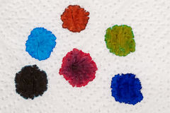 Ink blobs. Several fountain pen ink colours on a sheet of white paper stock photo