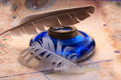 Ink bottle and feather pen Stock Photo