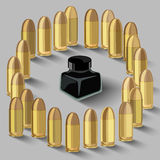 Ink bottle surrounded by bullets Stock Image