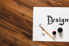Ink calligraphy design wooden background. Top view. Work with inks. Painter workshop, business inspiration, creativity, drawing school concept royalty free stock images