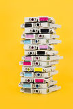 Ink cartridges exhausted stacked on yellow background Royalty Free Stock Image