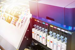 Ink cartridges and plotter stock photo