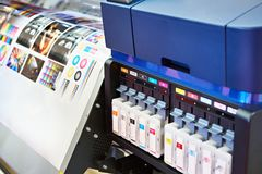 Ink cartridges and plotter Stock Images
