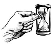 Sand clock. Ink drawing of a hand holding a sand clock Stock Photos