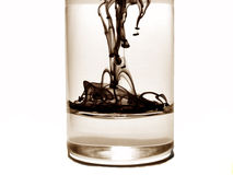 Ink drops in water glass Stock Image