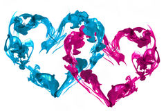 Ink hearts love. Blue and pink couple o hearts ink royalty free stock image