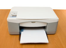 Ink-jet printer. Placed on a wood table stock image