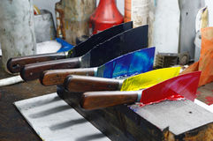The ink knives. Broadknives laded with ink wait to be used while printing a newspaper Stock Photos