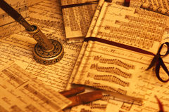 Ink and music. A closeup of an ancient pen and some music paper stock image