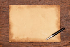 Ink pen and aged paper parchment.  Stock Images