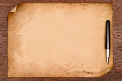 Ink pen and aged paper parchment.  Royalty Free Stock Photography