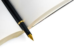 Ink pen on book Royalty Free Stock Images