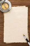 Ink pen and compass on parchment background Royalty Free Stock Image