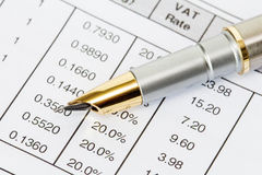 Ink pen on invoice document Royalty Free Stock Photography