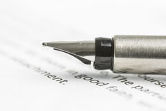 Ink pen on legal document Royalty Free Stock Image