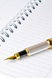 Ink pen on notebook Royalty Free Stock Photography