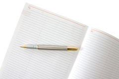 Ink pen and notebook Royalty Free Stock Photos