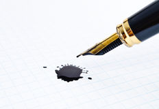 Ink pen and a notebook Royalty Free Stock Photos