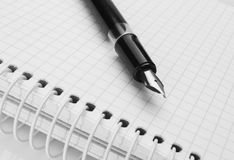 Ink pen on notepad Royalty Free Stock Images
