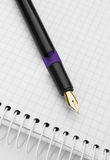 Ink pen on notepad Royalty Free Stock Photos