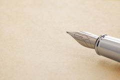 Ink pen and parchment Royalty Free Stock Images