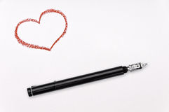 Ink pen and red heart. Red crayon heart and ink pen on white paper Royalty Free Stock Images