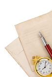 Ink pen at vintage envelope on white Royalty Free Stock Photography