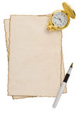Ink pen and watch at parchment on white Royalty Free Stock Photo