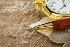 Ink pen and watch on wood Stock Images