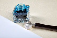 Ink pot and quill with sheets of paper Royalty Free Stock Photos