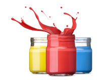Ink in primary colors. Bottles of ink in primary colors, red with splash Royalty Free Stock Photo