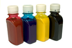 Ink for the printer. In bottles on a white background it is isolated Royalty Free Stock Photo