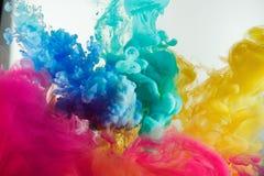 Ink rainbow color splash in water. Mix stock photo