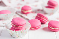 Ink raspberry macaroons on white wooden background Stock Image