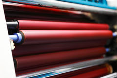 Ink rollers on offset printing machine royalty free stock photo