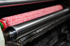 Ink rollers on offset printing machine Stock Photos