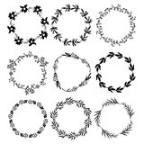 9 ink round floral frames. Hand drawn branches and flowers stock illustration