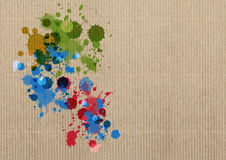 Ink splash on cardboard. Ink color splash on cardboard background Royalty Free Stock Photo