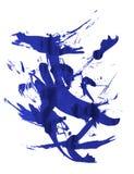 Ink splatter. Real blue splat on white background Royalty Free Stock Image